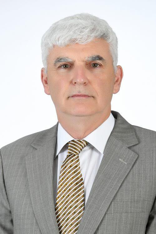 Dr. Athol Yates
